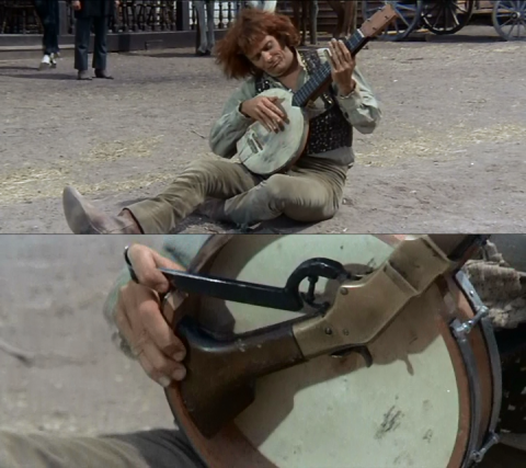 """""""Banjo"""" playing his banjo rifle, from the film """"Sabata"""" (1969)."""