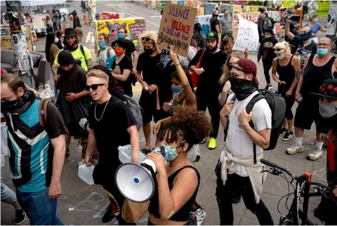A march through the Capitol Hill Organized Protest in Seattle on June 24.
